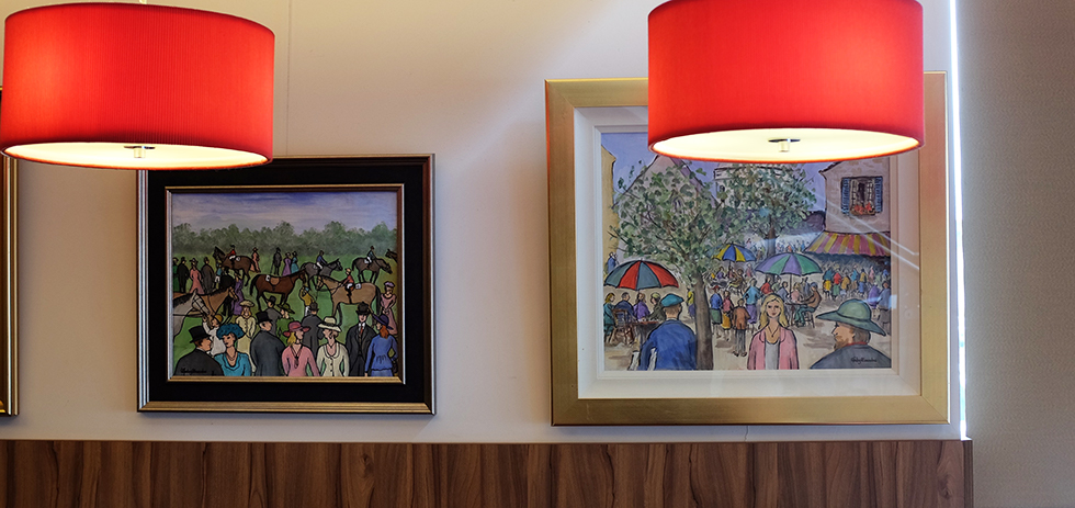 Works by Gladys Maccabe, among others, adorn the walls of Cafe Smart © Aptalops